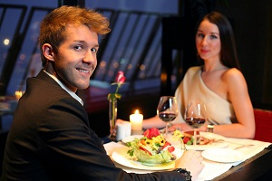 Man and woman at dinner in an expensive restaurant